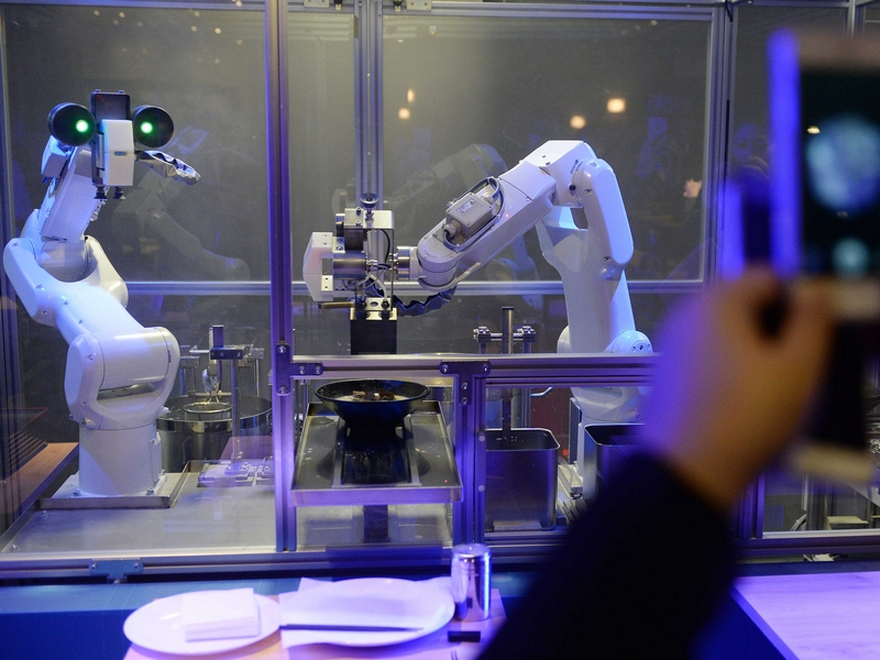 Two Robots Cook Noodles In Shanghai