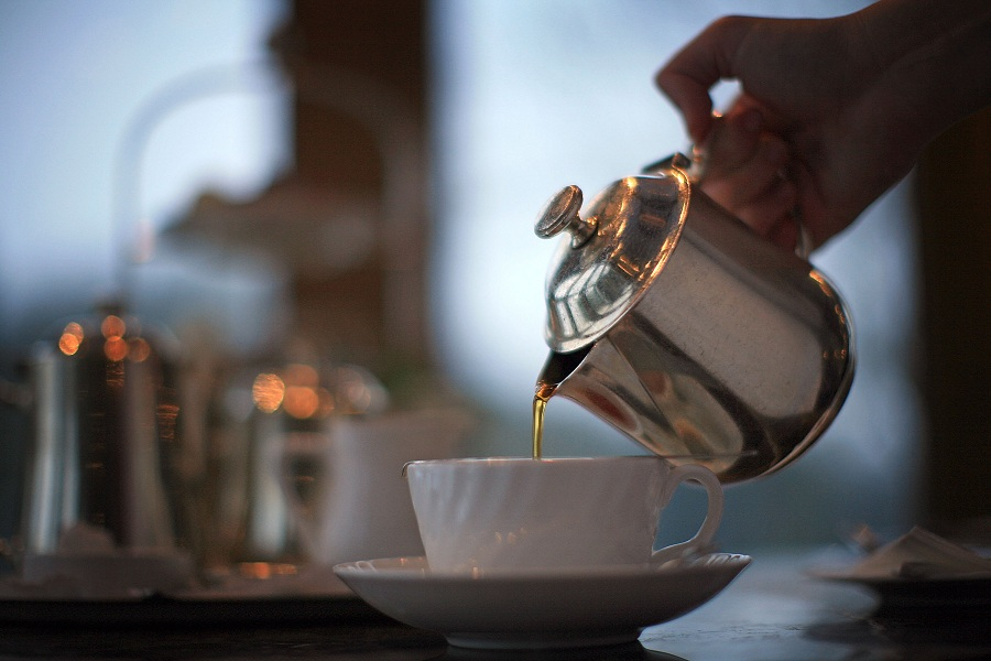 A waitress pours tea at Bettys Tea Room, Harlow Carr