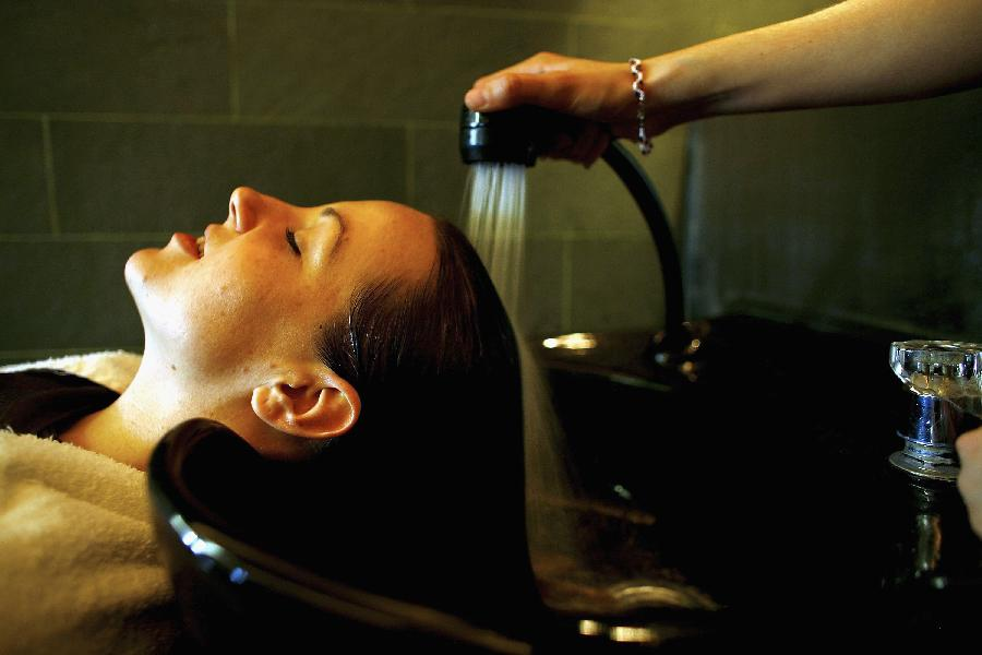 Girl getting shampoo