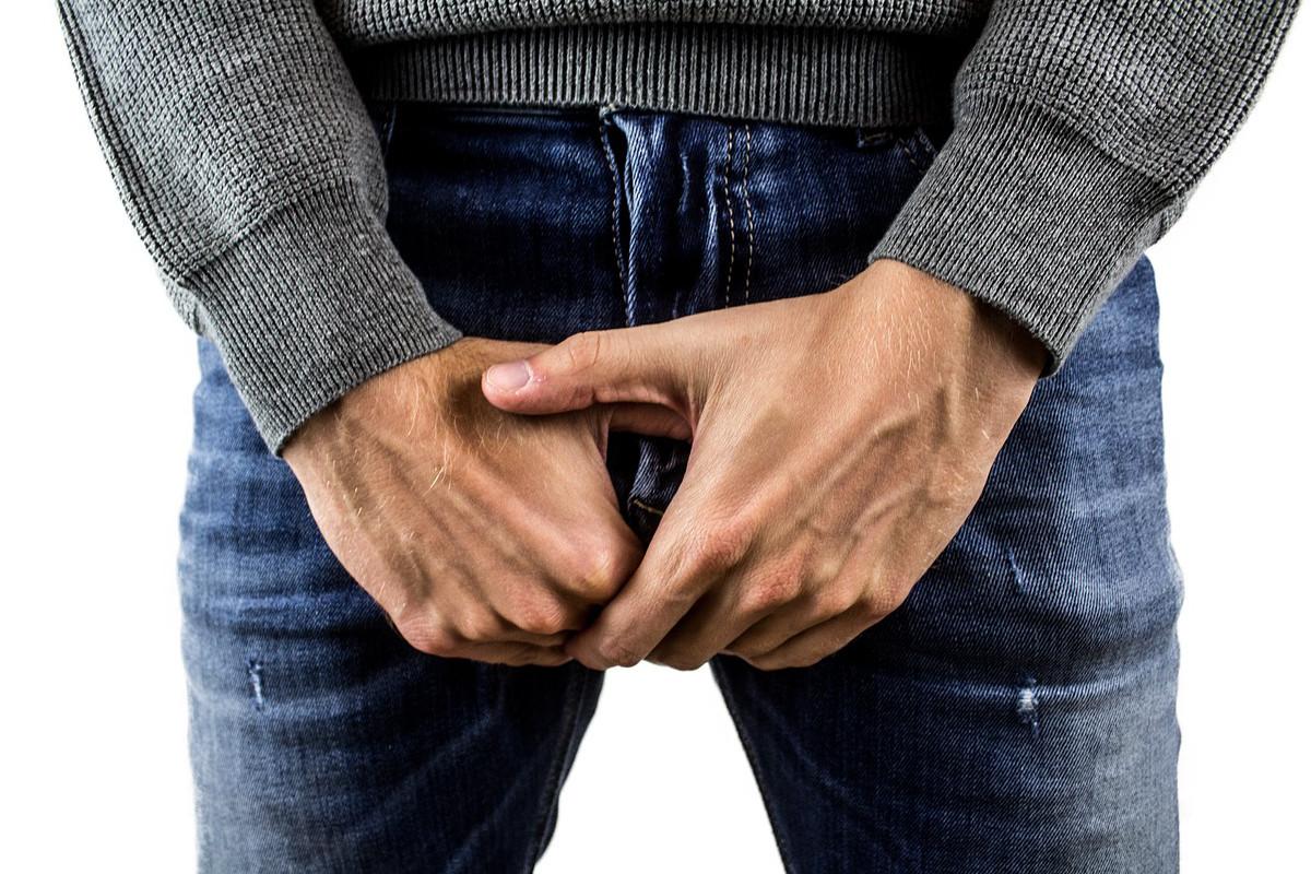 Man Holding His Genitals
