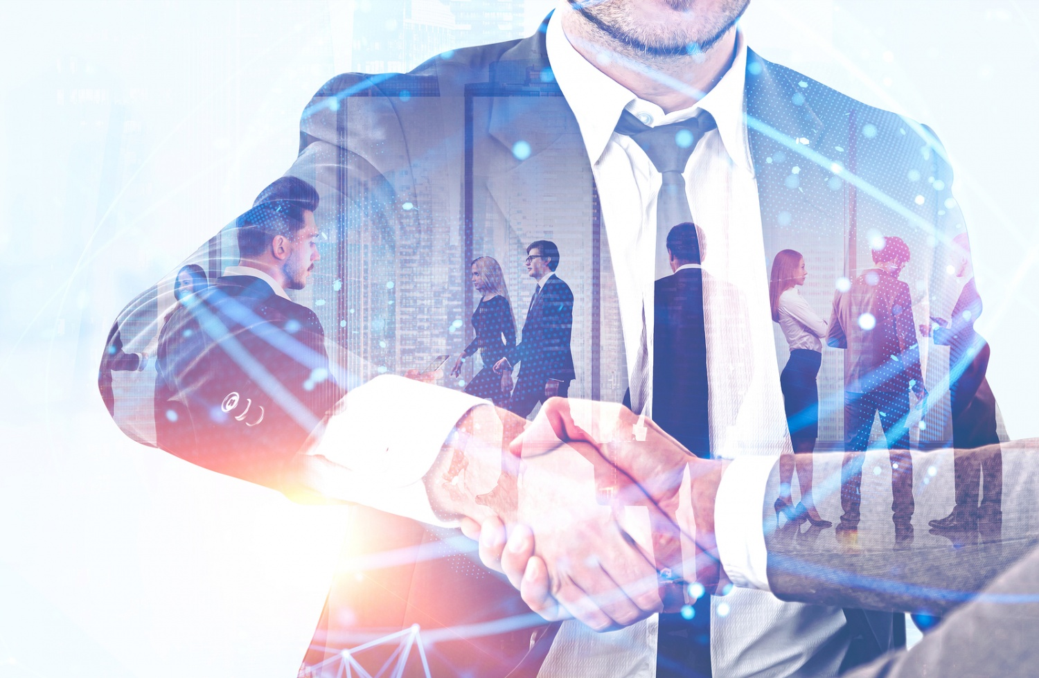 Handshake of business people with double exposure of their team working in office