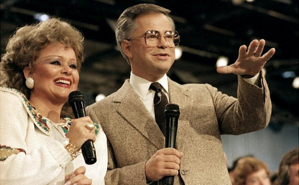 Jim Bakker during a PTL broadcast with his wife Tammy Faye, 1986.