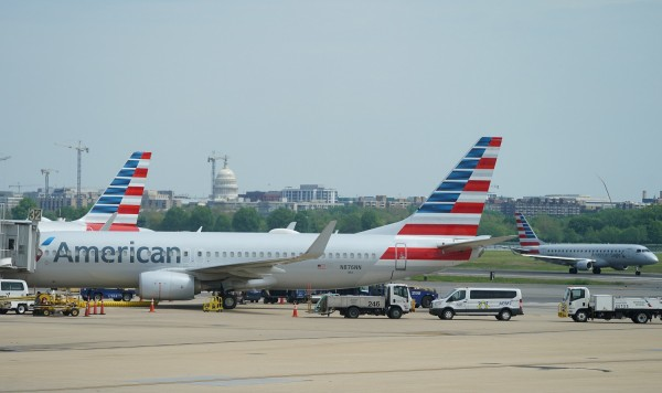 An American Airlines Boeing 737 jet sits at a gate at Washington's Reagan National airport