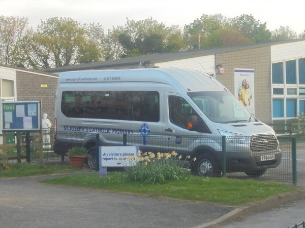 Ford Transit minibus at St. Joseph's Primary School, Wetherby, West Yorkshire. Taken on the evening of Easter Monday the 22nd of April 2019.