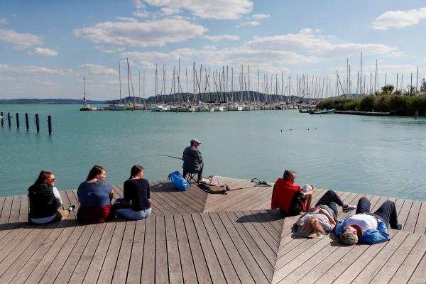 People enjoy the sun on the shore of Lake Balaton, following the outbreak of the coronavirus disease (COVID-19), in Balatonfured