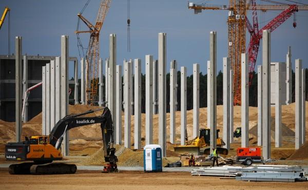Cranes and first pillars for the future Tesla Gigafactory in Gruenheide near Berlin