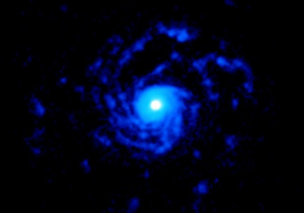 Strange Spiral Structures Extending Out of Young Star Reaches Out 1,000X the Distance of Sun and Earth