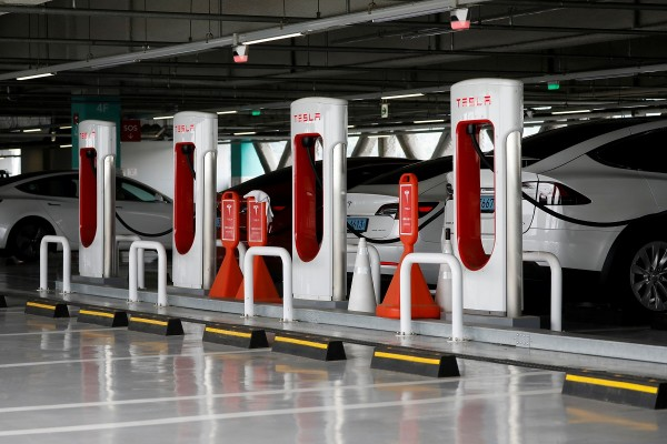 Tesla electric vehicles are charged at a Tesla Supercharger charging station in Hanam