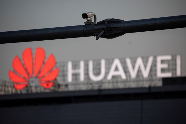 A surveillance camera is seen in front of a Huawei logo, in Belgrade