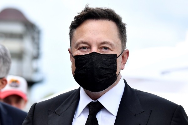 Elon Musk wears a protective mask as he arrives to attend a meeting with the leadership of the conservative CDU/CSU parliamentary group, in Berlin
