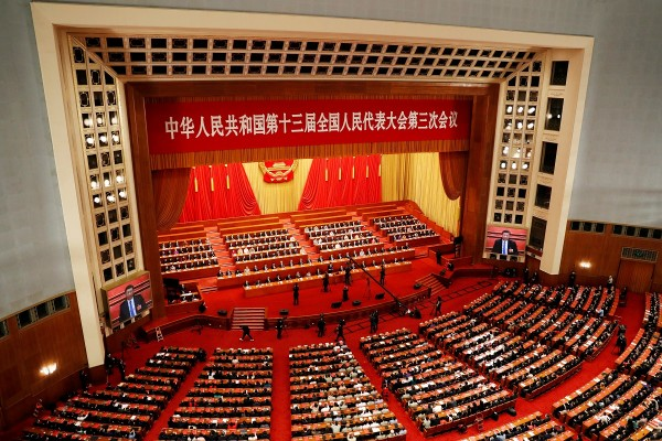 Chinese officials and delegates attend the closing session of NPC in Beijing