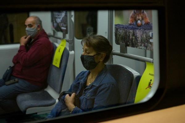 Commuters wearing protective face masks are seen on board a train, amid the spread of the coronavirus disease (COVID-19), in Athens