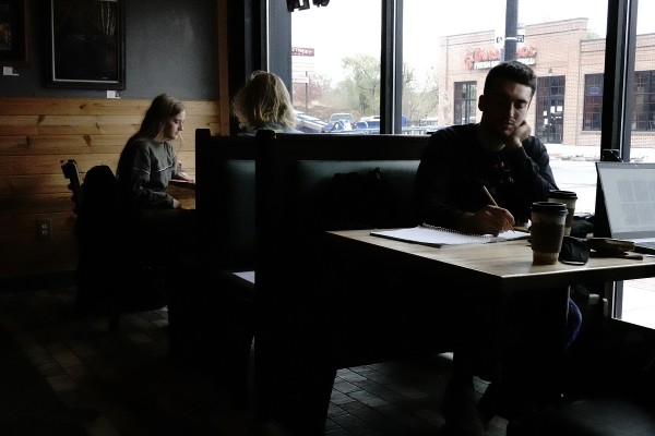 University of Wisconsin-Eau Claire students study inside The Goat Coffee House as the coronavirus disease (COVID-19) outbreak continues