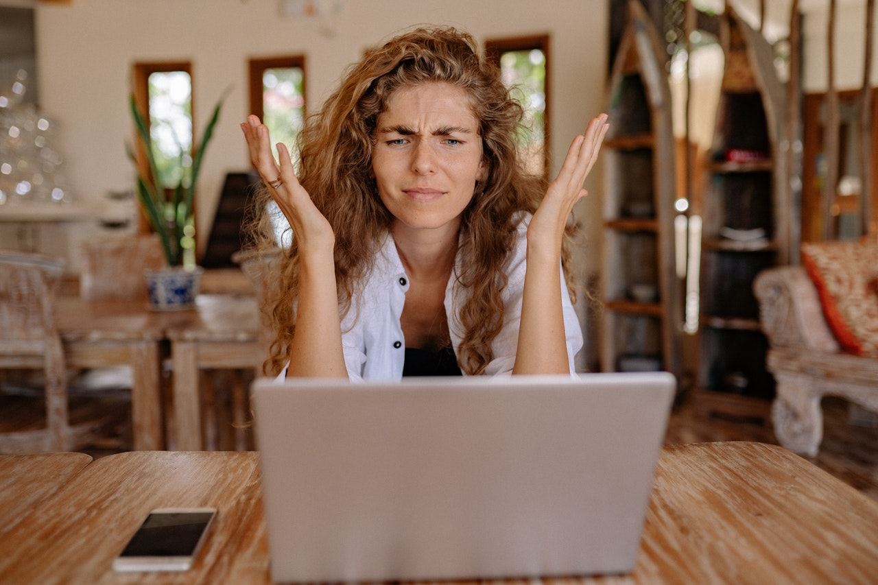 Photo of Woman Showing Frustrations on Her Face