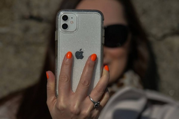 woman holding an apple iphone