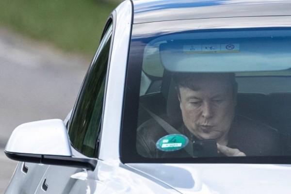 Elon musk in car