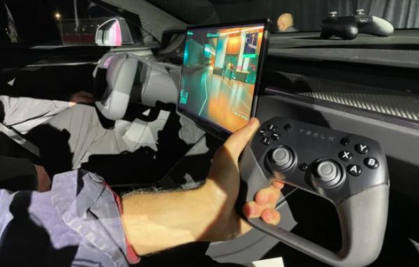 Elon Musk Plays 'Cyberpunk 2077' on Tesla Model S Plaid To Flaunt Gaming Performance— Tesla Branded Controller Seen?