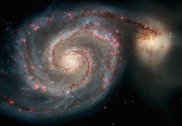 NASA Hubble Space Telescope Captures Spiral Galaxy In Very Unusual Location, Has Planets With Extremely Active Centers