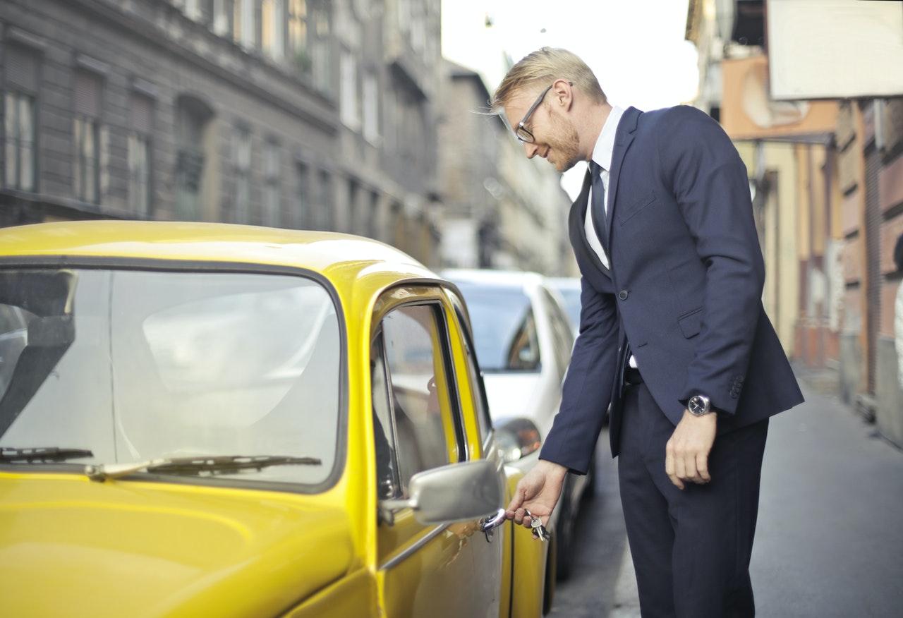 Man Unlocking His Car